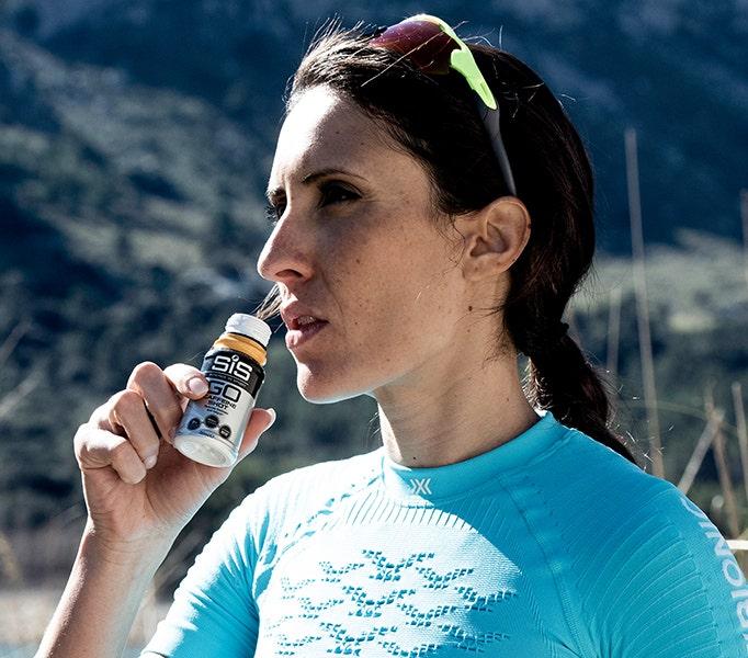 woman drinking Caffeine Shot