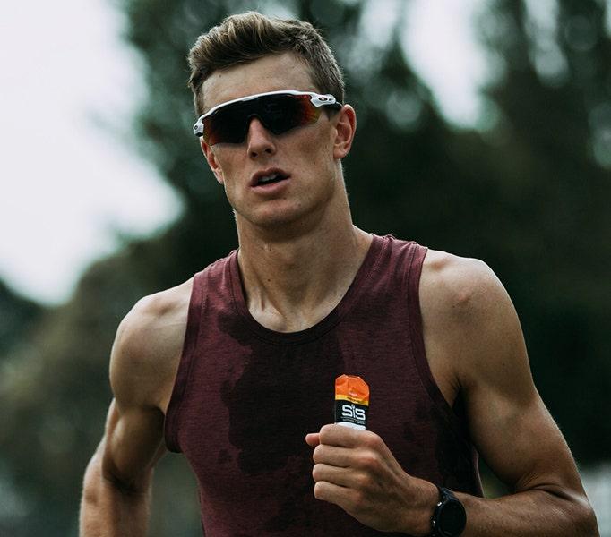 man running with energy gel